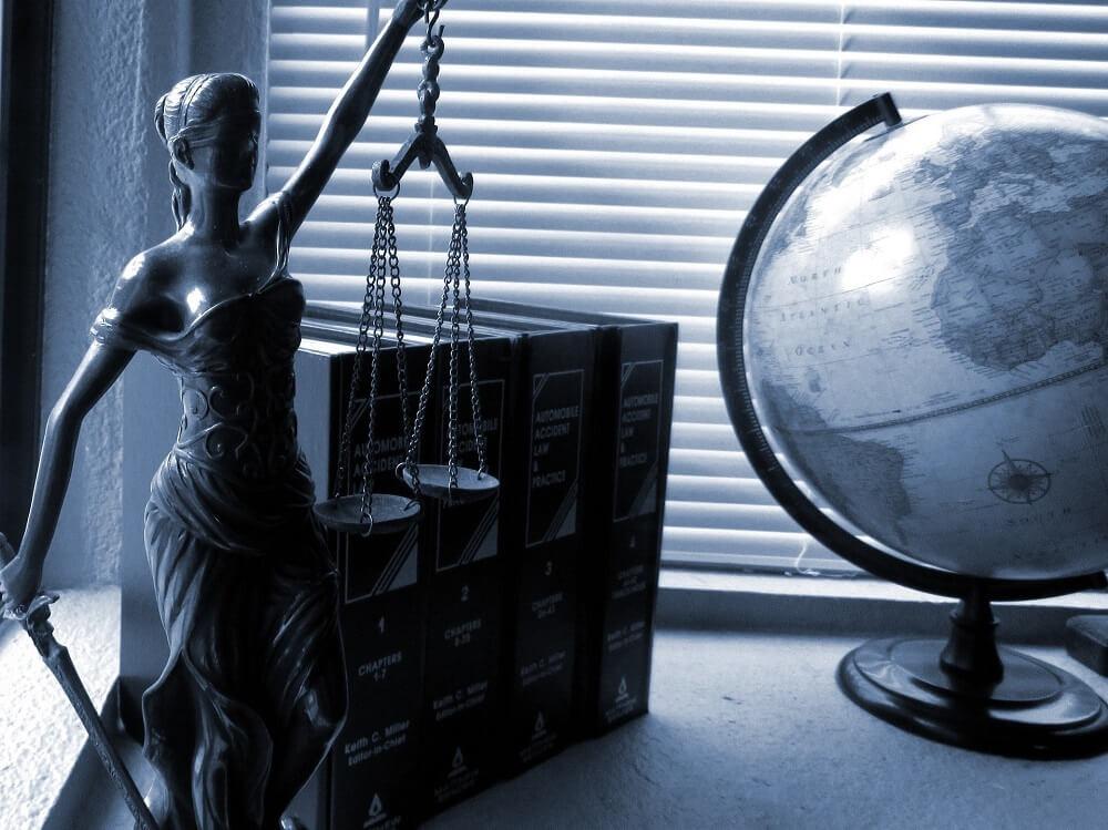 luis aguirre california lemon law attorney scales of justice